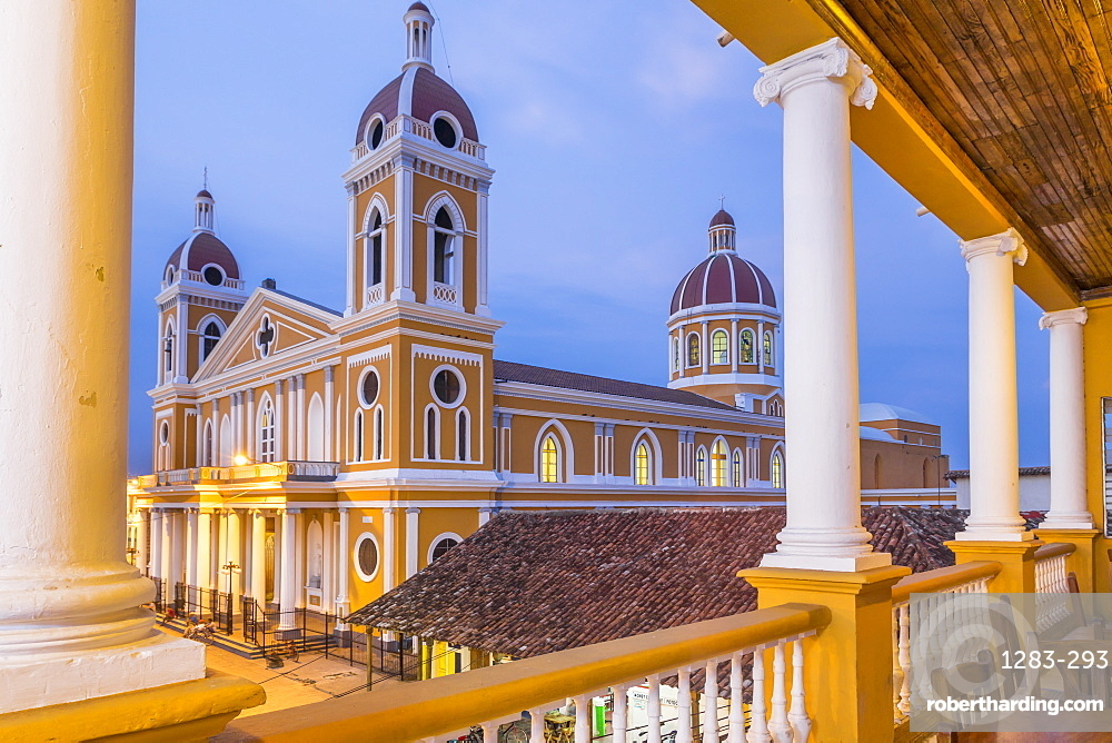 The Cathedral of Granada seen from the balcony of a bar at dusk, Granada, Nicaragua, Central America