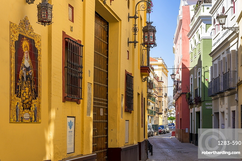 Narrow street in the historical centre, Seville, Andalusia, Spain, Europe