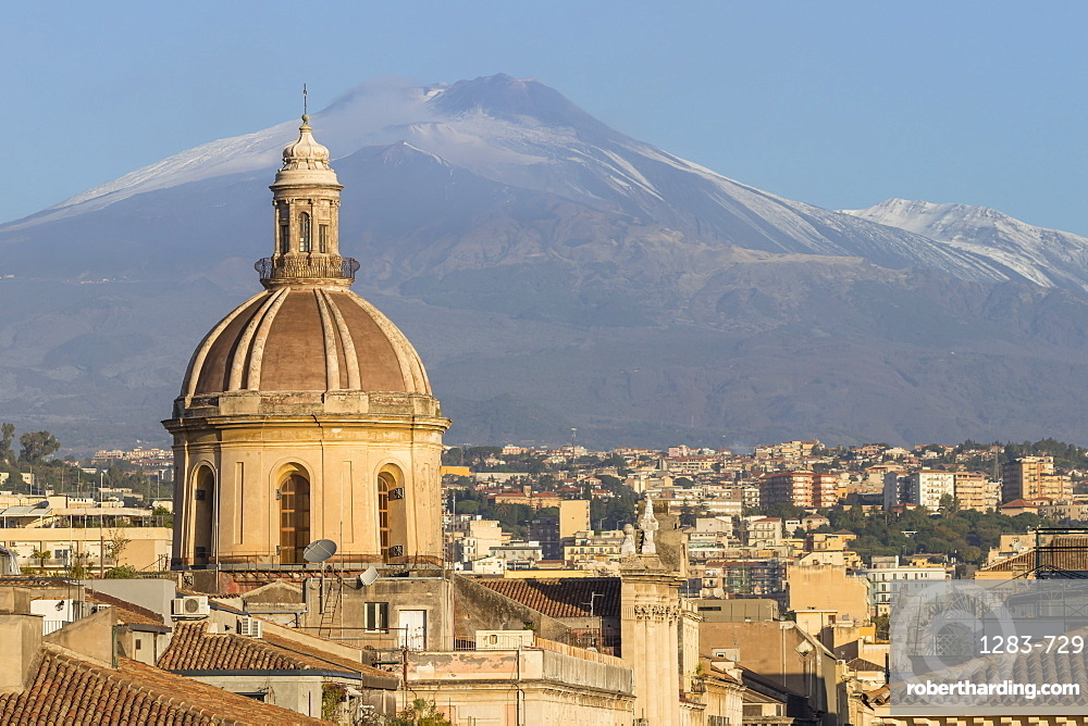 The cupola of Saint Michael church and Mount Etna in the background, Catania, Sicily, Italy, Europe