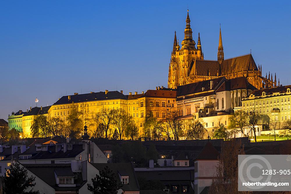 Illuminated Prague Castle and St. Vitus Cathedral at dusk, UNESCO World Heritage Site, Prague, Bohemia, Czech Republic, Europe