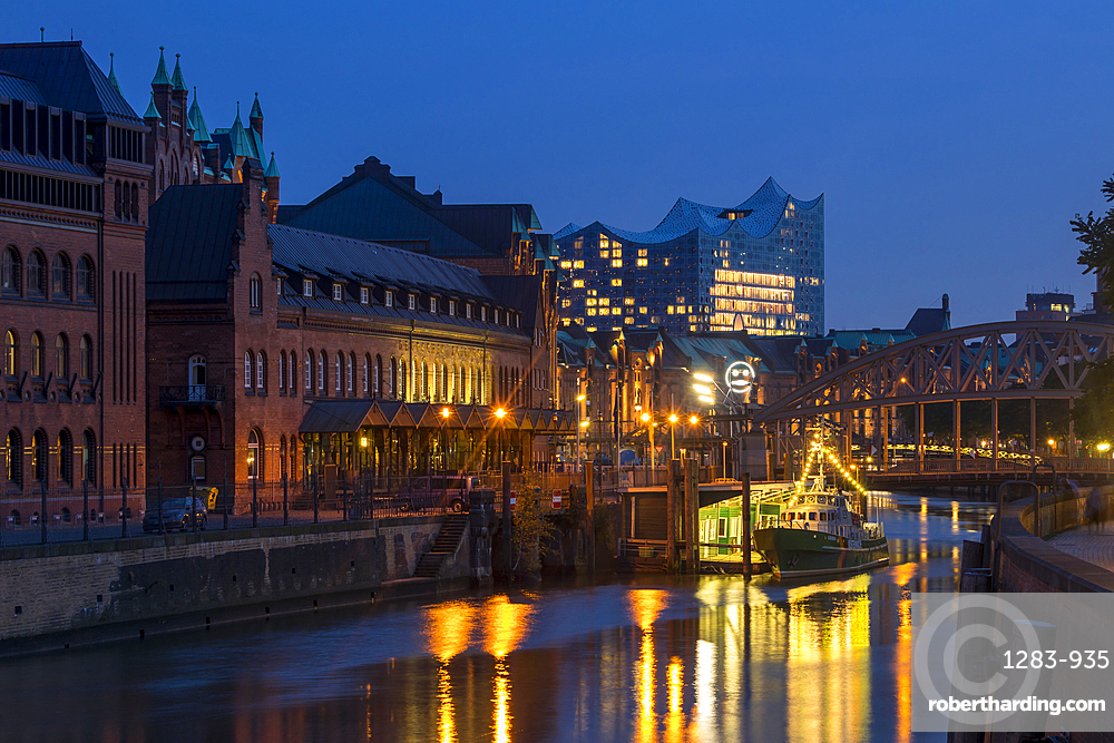 Historical buildings of the Speicherstadt with the Elbphilharmonie building in the background, Hamburg, Germany, Europe
