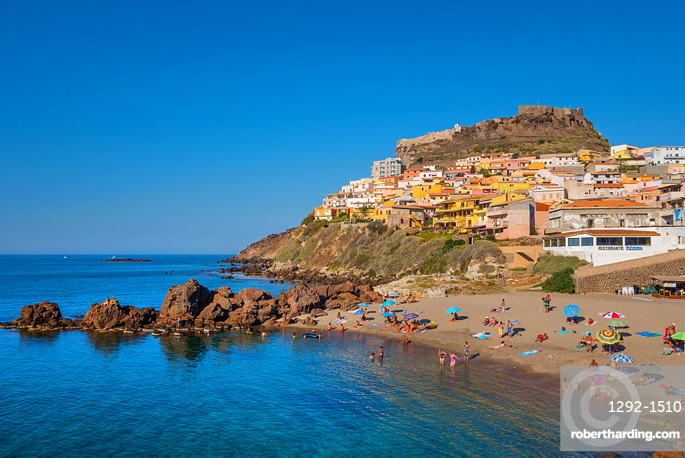Tourists on beach of Castelsardo, Sardinia, Italy, Europe