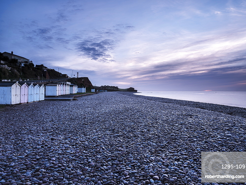 Twilight scene with beach huts and dew laden glistening pebbles on the beach at Budleigh Salterton, Devon, England, United Kingdom, Europe