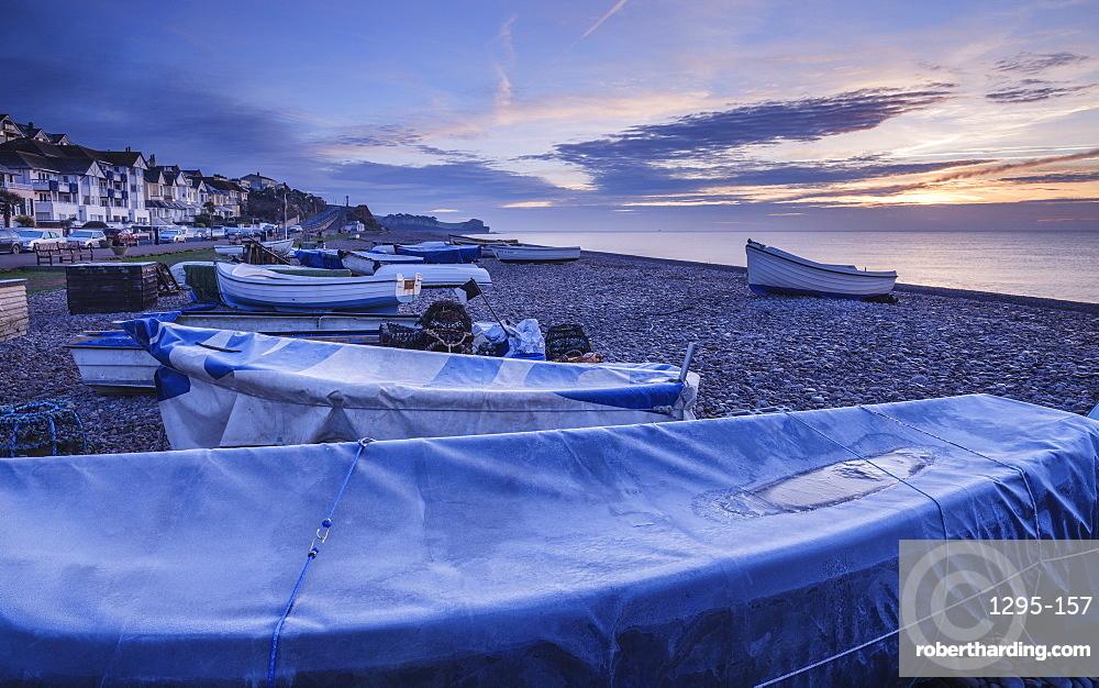 Serene dawn scene of fishing boats on the pebbled beach at Budleigh Salterton, Devon, England, United Kingdom, Europe