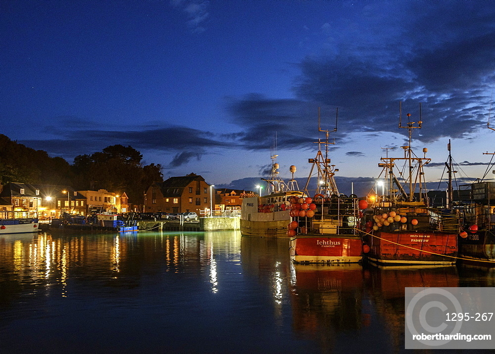Boats and lights in the harbour of the popular fishing port of Padstow, Cornwall, England, United Kingdom, Europe