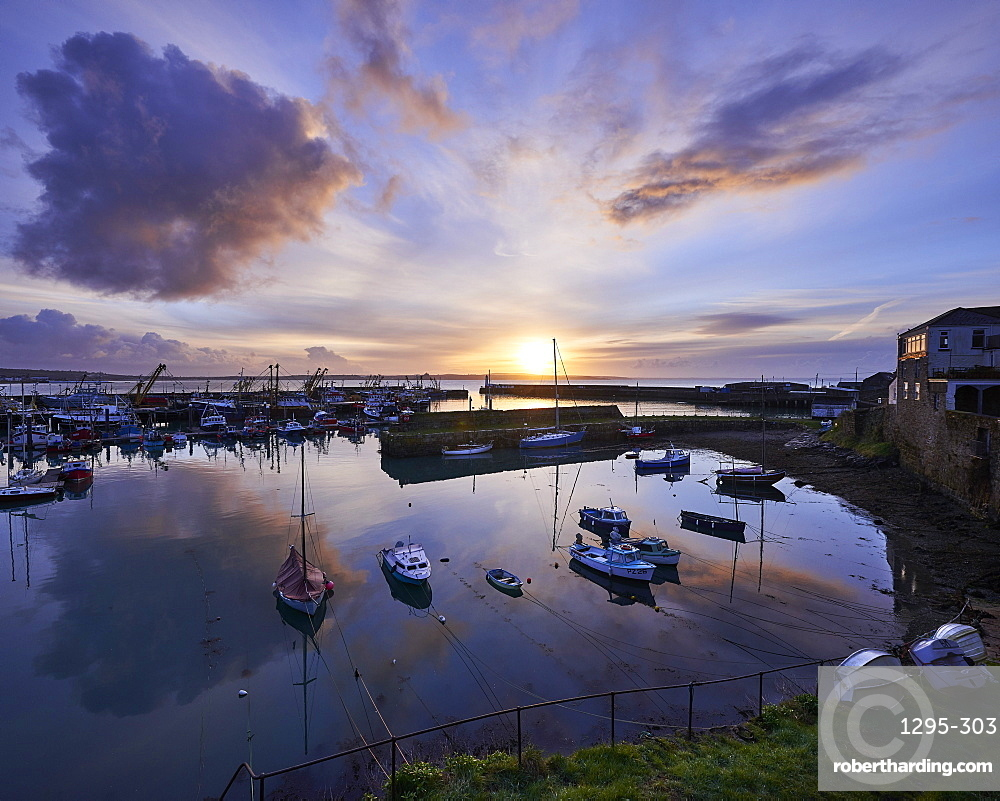 Spring sunrise across the harbour at the fishing port of Newlyn, Cornwall, England, United Kingdom, Europe