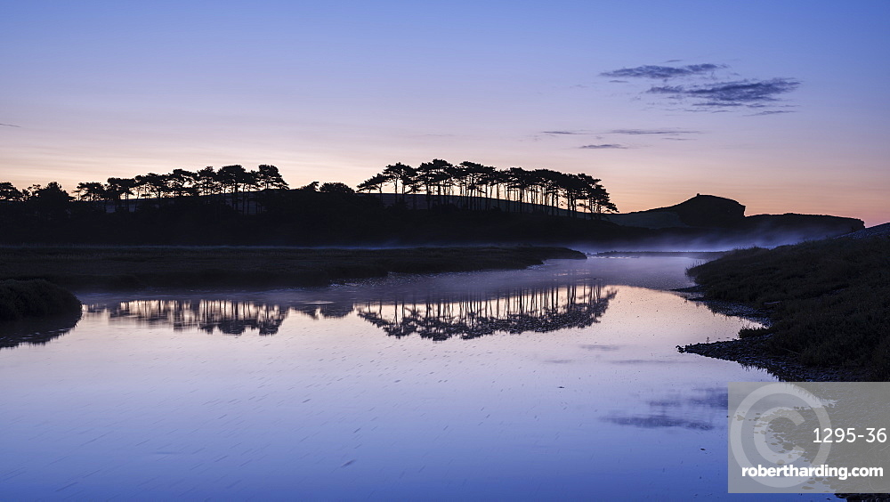 Twilight with a rising mist and perfect reflections on the River Otter at Budleigh Salterton, Devon, England, United Kingdom, Europe