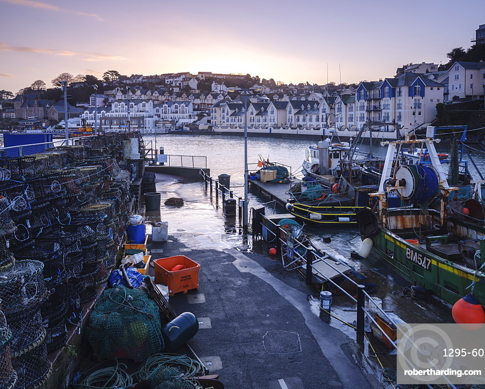 High tide at dawn in the harbour of the fishing port of Brixham, Devon, England, United Kingdom, Europe