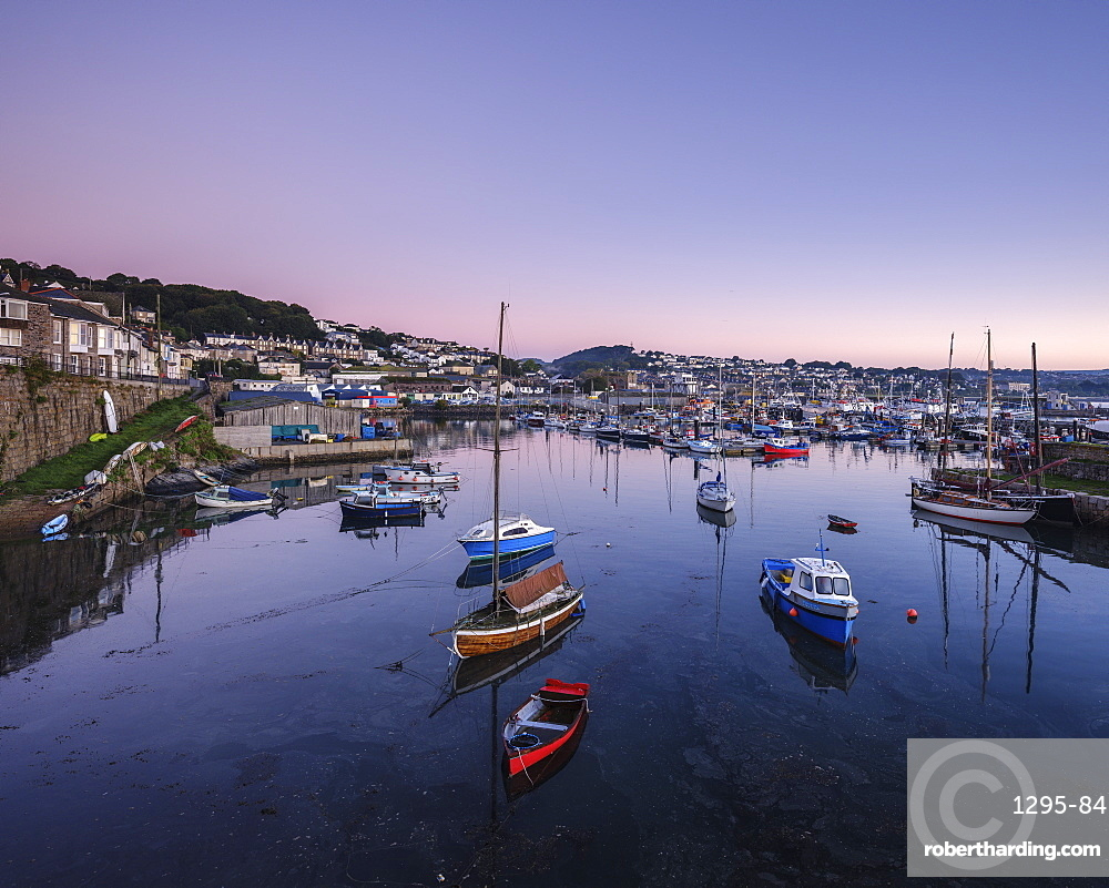 Twilight looking across the inner harbours at the fishing port of Newlyn, Cornwall, England, United Kingdom, Europe