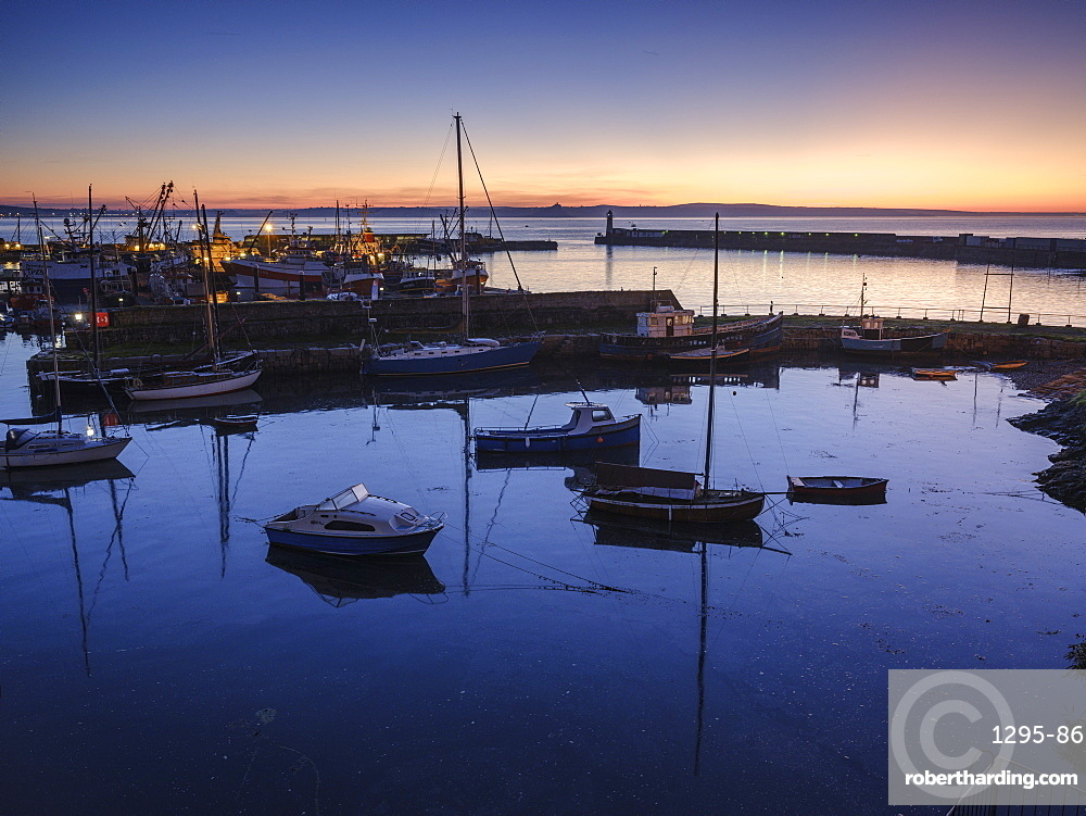 Sunrise looking across the inner and outer harbours at the fishing port of Newlyn, Cornwall, England, United Kingdom, Europe