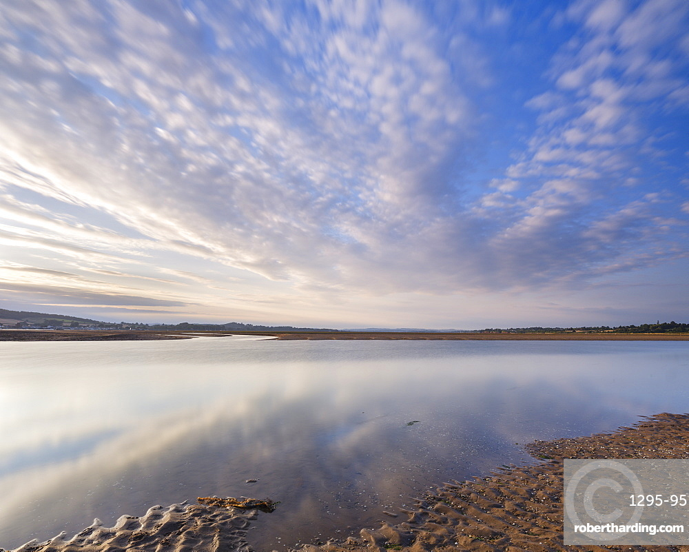 Looking North up the Exe estuary with interesting clouds and reflections from Exmouth, Devon, England, United Kingdom, Europe