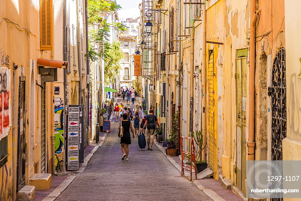 The narrow streets of the old town, Le Panier, in Marseille in France, Europe.
