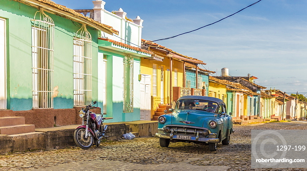 A classic car in a colourful colonial street in Trinidad, UNESCO World Heritage Site, Cuba, West Indies, Caribbean, Central America