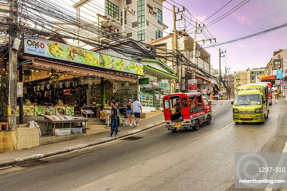 A street scene and local taxis and tuk tuks in Kata, Phuket, Thailand, Southeast Asia, Asia