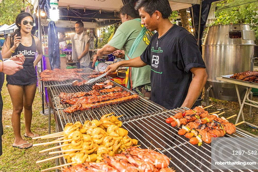 A food stall selling grilled meat in the night market in Kamala in Phuket, Thailand, Southeast Asia, Asia