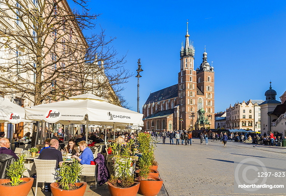 A cafe scene in the main square, Rynek Glowny, in the medieval old town, UNESCO World Heritage Site, in Krakow, Poland, Europe