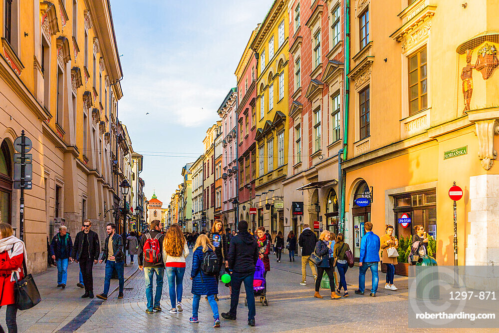 A street scene in the medieval old town, a UNESCO World Heritage site, in Krakow, Poland, Europe.