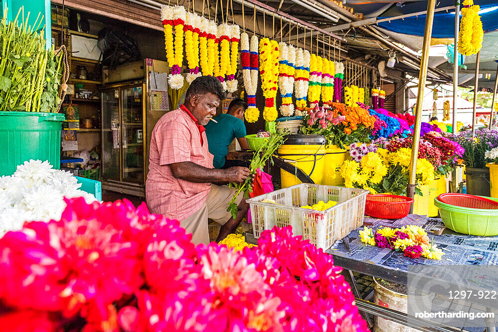 Colourful traditional garland maker in George Town, a UNESCO World Heritage site, Penang Island, Malaysia, Southeast Asia, Asia.