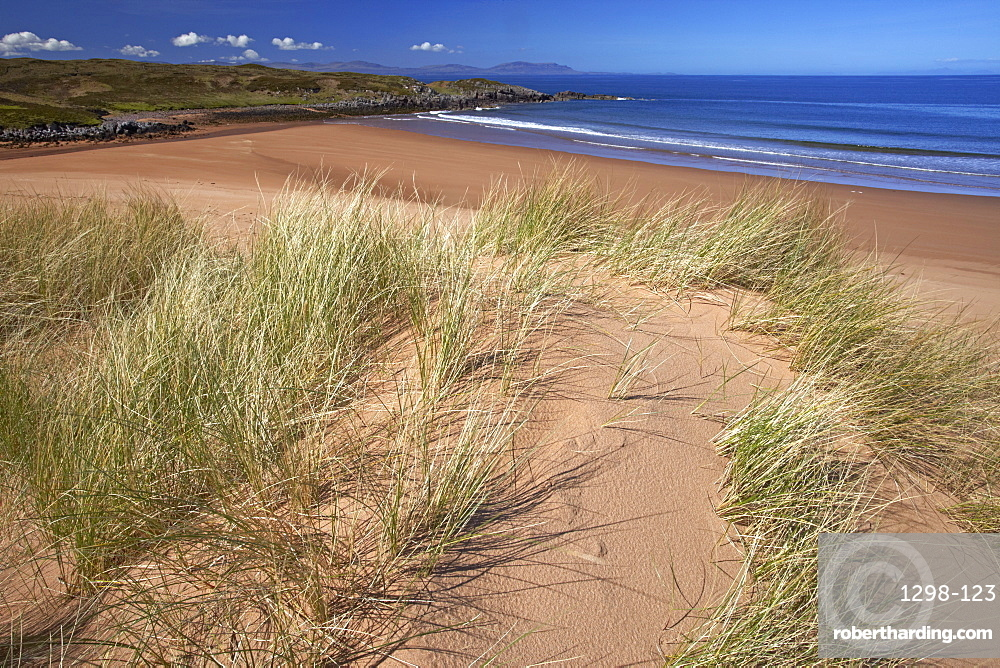 The remote sandy beach at Red Point with the Isle of Skye on the horizon, Wester Ross, Scotland, United Kingdom, Europe