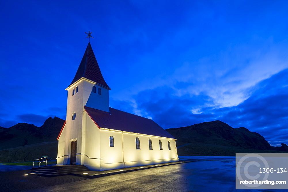 Floodlit church at dawn, near Vik, South Iceland, Iceland, Polar Regions