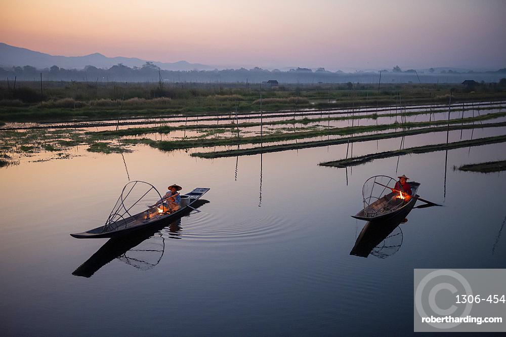 Two Intha leg rowing fisherman at Inle Lake gardens, Inle Lake, Shan State, Myanmar (Burma), Asia