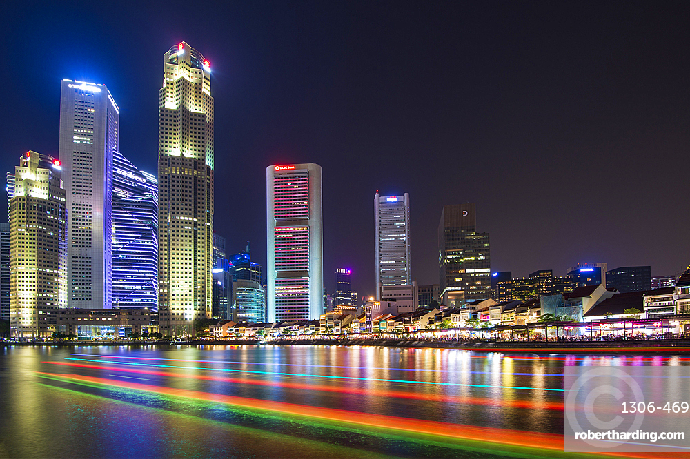 Clarke Quay with boat light trails at night, Singapore, Southeast Asia, Asia