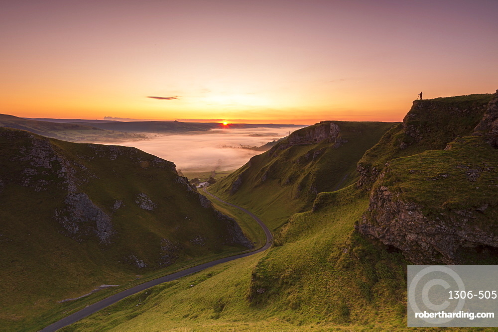 A photographer at Winnats Pass at sunrise, Hope Valley, Edale, Peak District, Derbyshire, England, United Kingdom, Europe
