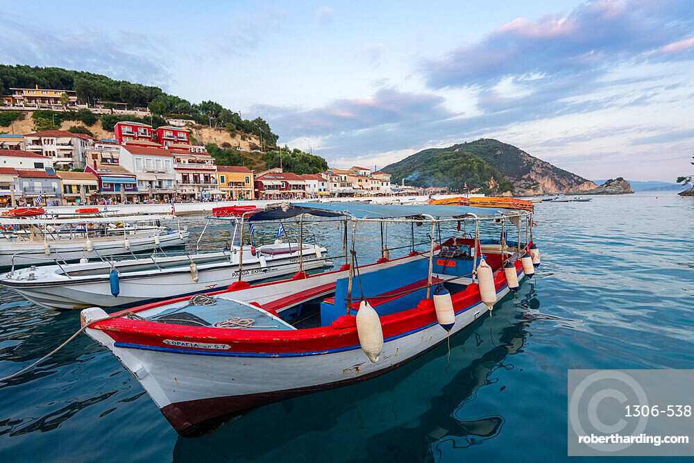 Tourist boats and the town of Parga in the background, Parga, Preveza, Greece