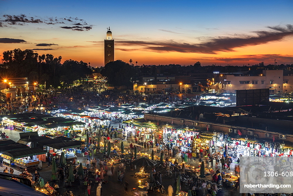 View over the Djemaa el Fna at dusk showing food stalls and crowds of people, Marrakech, Morocco, North Africa, Africa