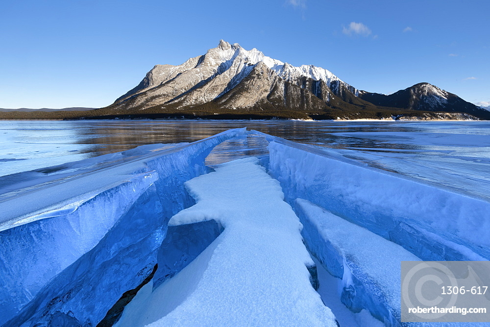 Ice formations with Mount Michener in the background at sunrise, Abraham Lake, Kootenay Plains, Alberta, Canadian Rockies, Canada, North America
