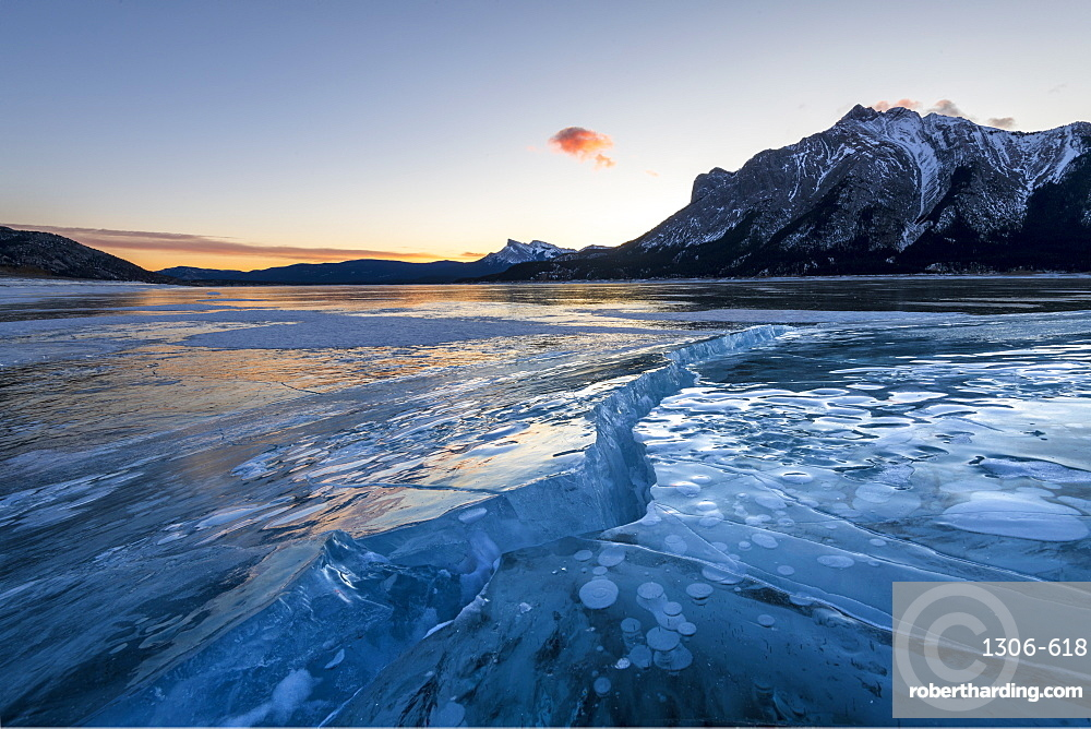 Ice formations with Mount Michener and Kista Peak in the background at sunrise, Abraham Lake, Kootenay Plains, Alberta, Canadian Rockies, Canada, North America