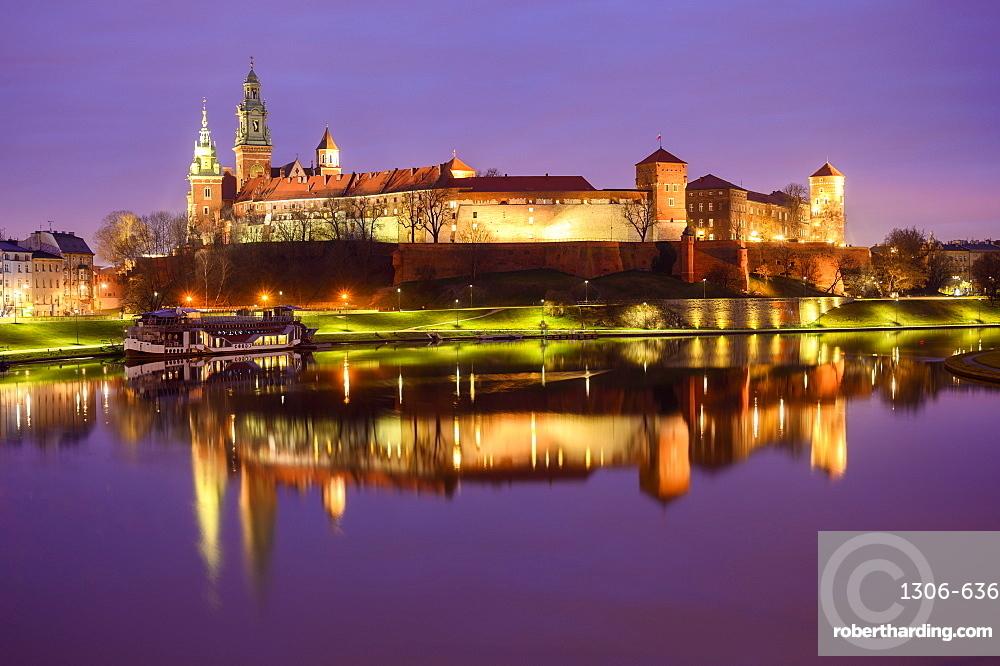 Wawel Castle, reflected in Vistula River, at night, Krakow, Poland