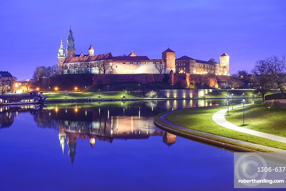Wawel Castle reflected in the Vistula River, at night, Krakow, Poland