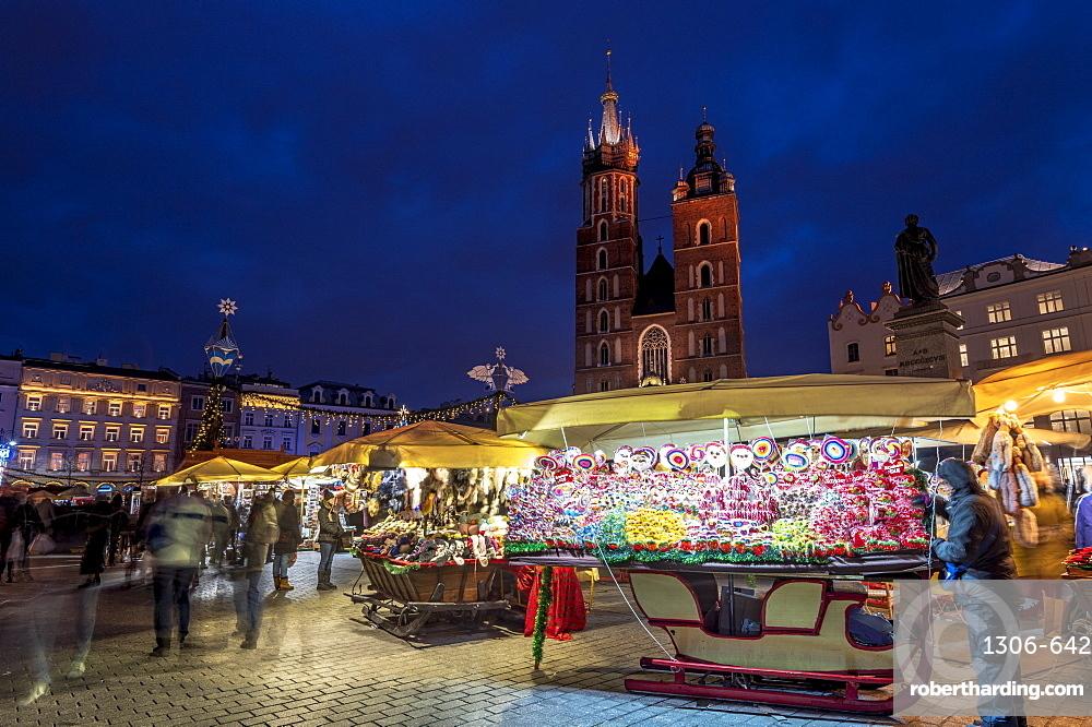 Christmas markets at night with Saint Mary's Basilica, Market Square, Krakow, Poland