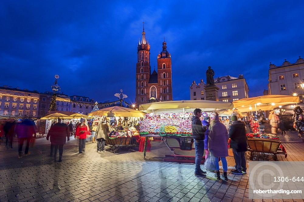 Christmas stalls at night with Saint Mary's Basilica, Market Square, Krakow, Poland