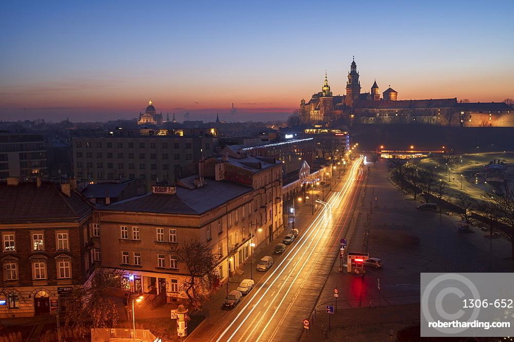 Wawel Castle at sunrise with traffic trails, Krakow, Poland