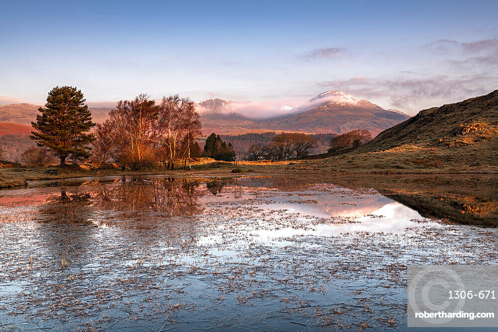 Partially frozen Kelly Hall Tarn and view of Coniston Old Man, Lake District National Park, UNESCO World Heritage Site, Cumbria, England, United Kingdom, Europe