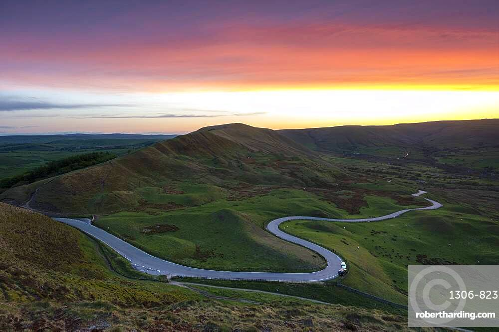 Sunset at Rushup Edge with winding road leading to Edale, Peak District, Derbyshire