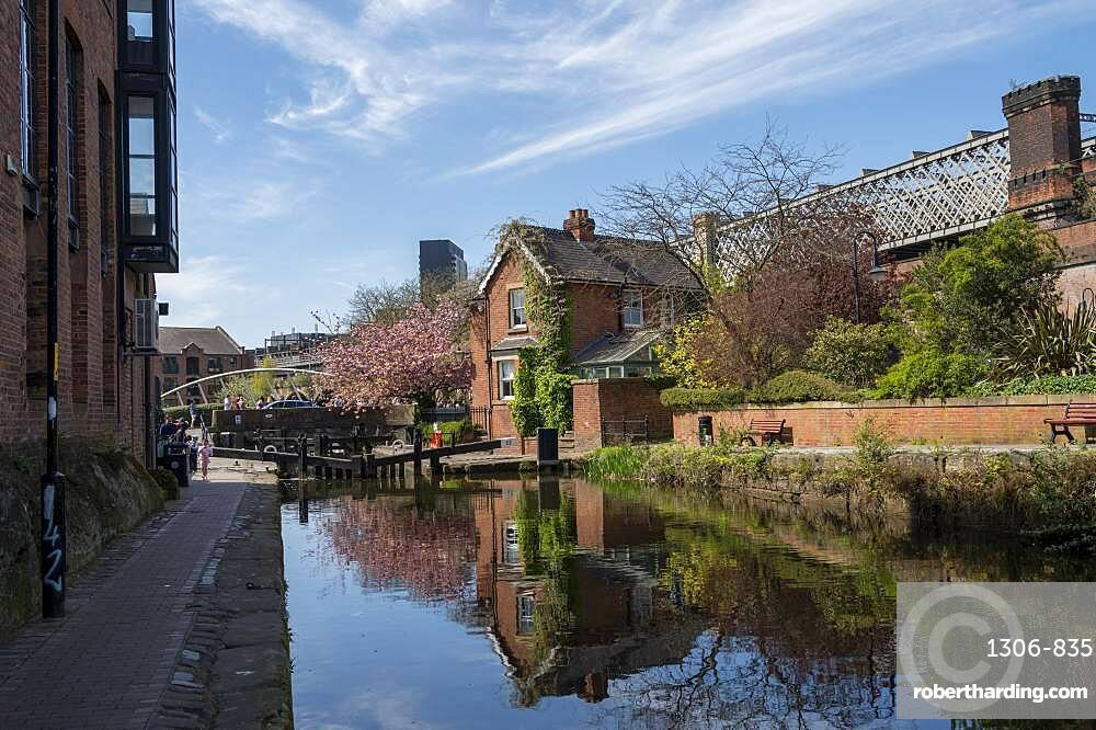 The Castlefield canal with lock keeper house reflected in spring, Manchester