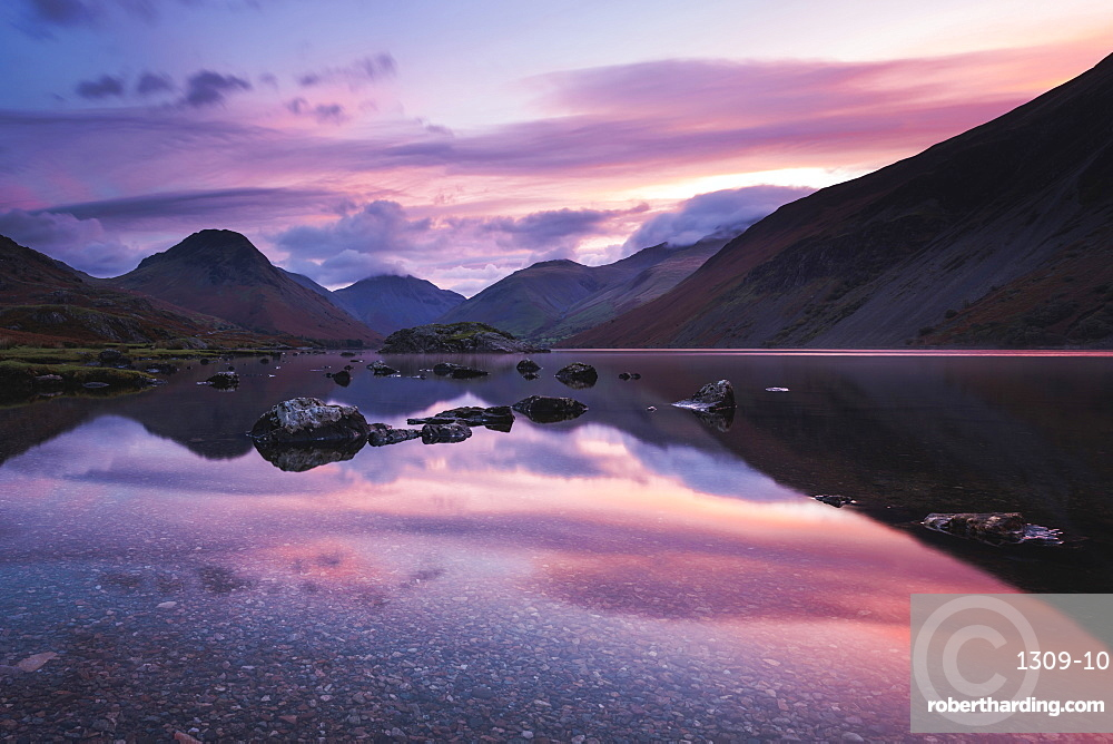 Pink clouds reflected in tranquil Wast Water, dawn, Wasdale, Lake District National Park, UNESCO World Heritage Site, Cumbria, England, United Kingdom, Europe