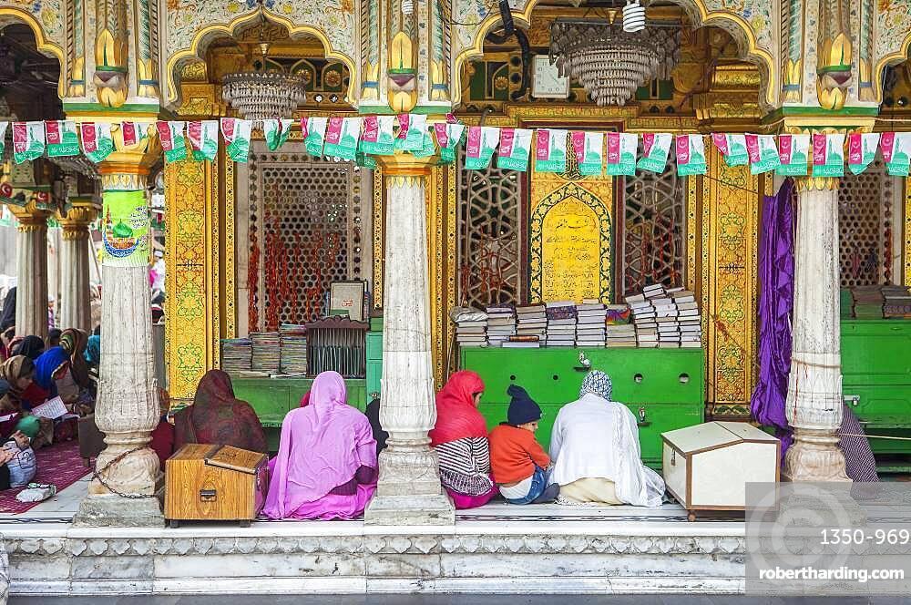 Praying, in Hazrat Nizamuddin Dargah, Delhi, India