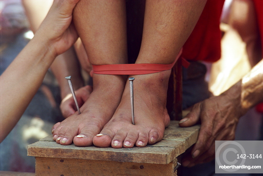 Lucy Reves crucifixion during Holy Week at Easter in Capitanan village in Bulacan Provice, Philippines, Southeast Asia, Asia