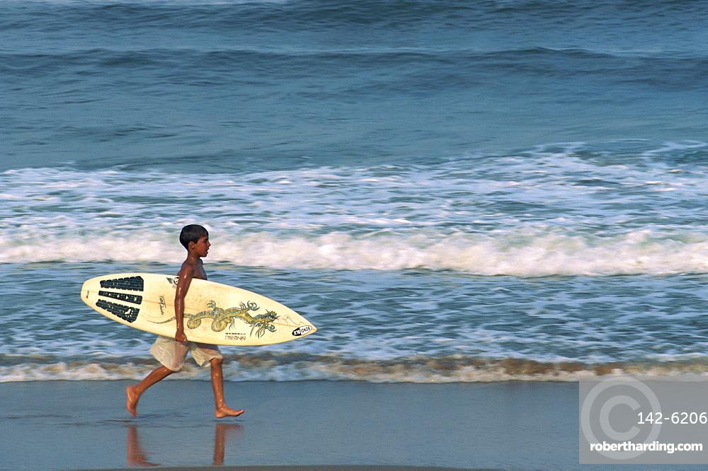 Boy surfing at North Beach, Indian Ocean, Durban, KwaZulu-Natal, South Africa, Africa