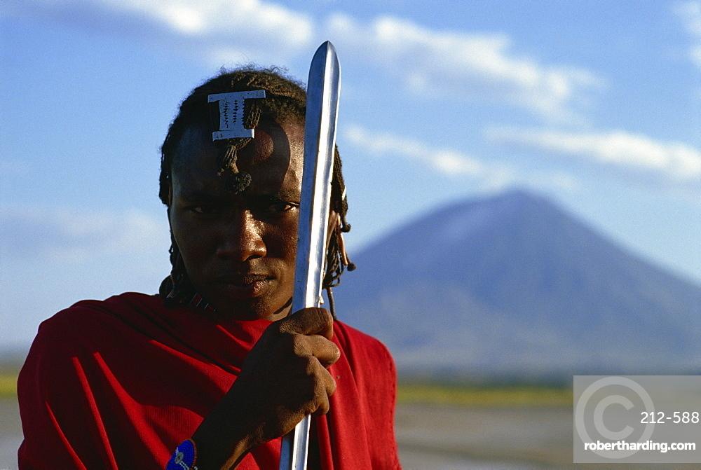 Masai Moran with Lengai, the Masai Mountain of God in background, Tanzania, East Africa, Africa