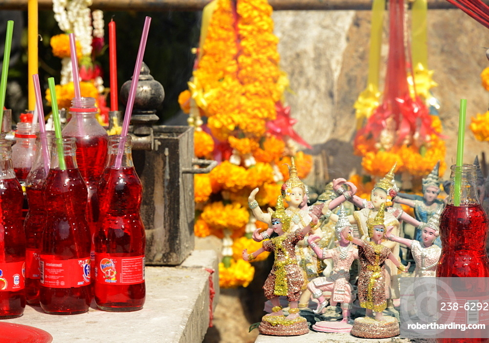 Red drinks offered to a Pig shrine, the Pig is the astrological symbol of the year a past queen was born, Bangkok, Thailand. Southeast Asia, Asia