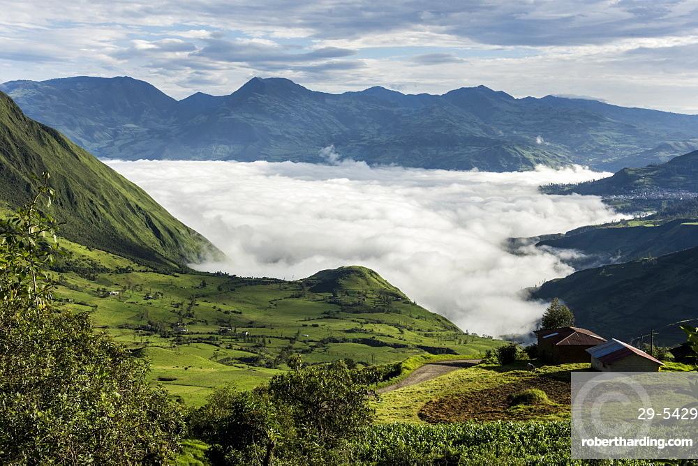 Valley filled with cloud in Andes central highlands, hiding the Nariz del Diablo railway below Chunchi, Ecuador, South America
