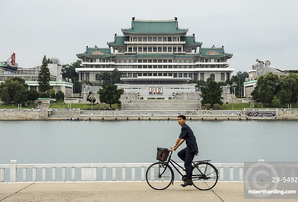 Grand People's Study House and Kim Il Sung Square, seen across Taedong River, Pyongyang, North Korea, Asia