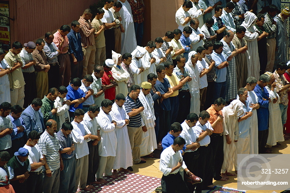 Friday prayers at mosque in Djemaa el Fna, Marrakech, Morocco, North Africa, Africa