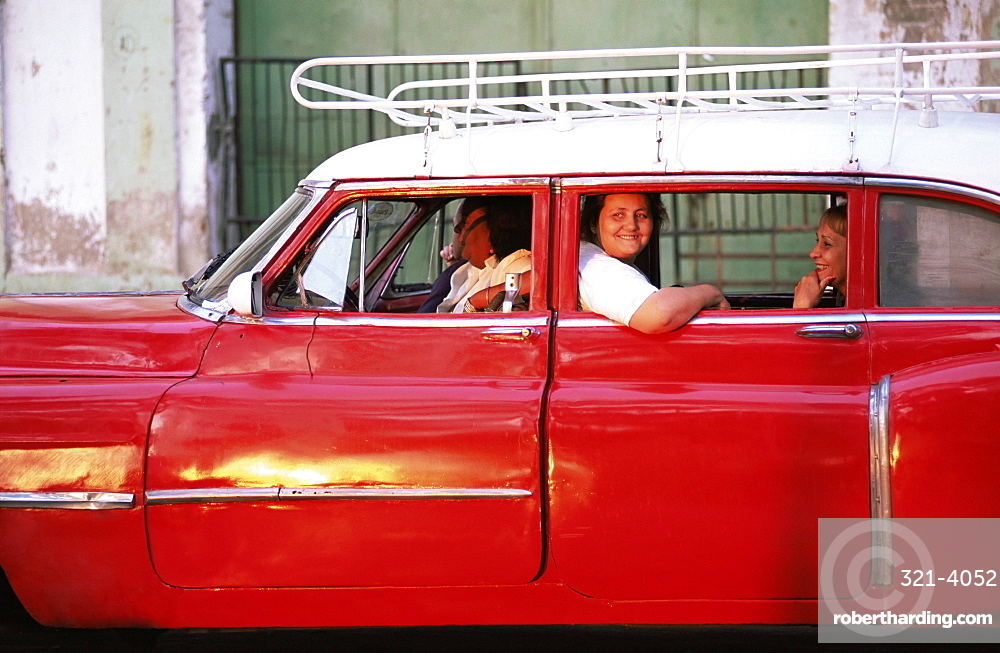 Women waiting in taxi in the early morning, Havana, Cuba, West Indies, Central America