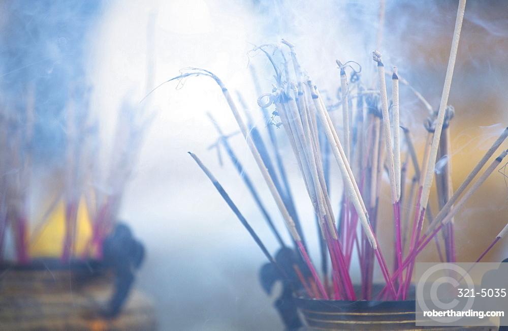 Incense burning at Shwedagon Paya (Shwedagon Pagoda), Yangon (Rangoon), Myanmar (Burma), Asia